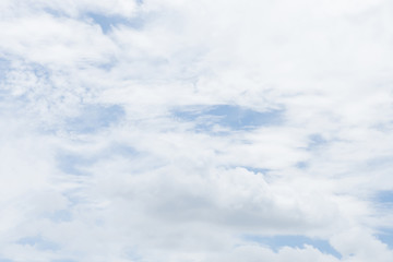 Soft white clouds with light blue sky for background