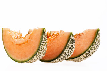 Pieces of melon cantaloupe isolated on white background.