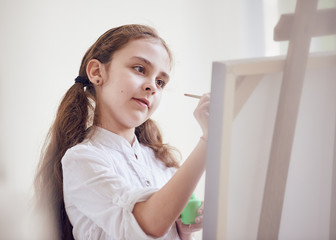 young artist painting portrait