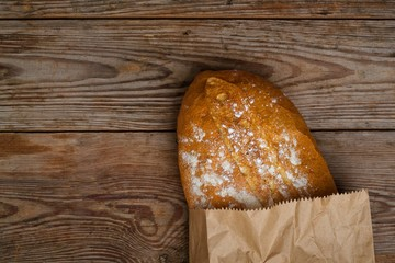 homemade bread on wooden background. top view