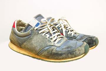 Old running shoes isolate on a white background