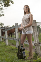 The girl with a guitar and horses