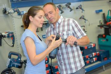 Man and woman looking at power tools