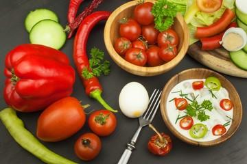 Fresh vegetables for snacks with dressing. Dip for vegetables. Healthy diet meal for dinner. Preparing vegetables in a home kitchen.