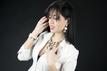 Beautiful woman with evening make-up. Jewelry and Beauty.