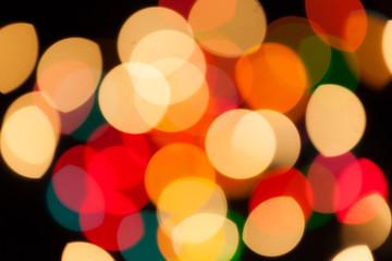 bunte Lichtpunkte auf schwarzem Hintergrund