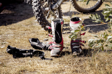 motorcycle racing, boots and racer gloves after competition Enduro