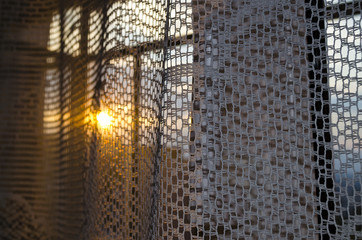 Sunset and window with curtains evening light abstract background