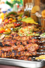 Barbecue skewers with juicy meat on tray