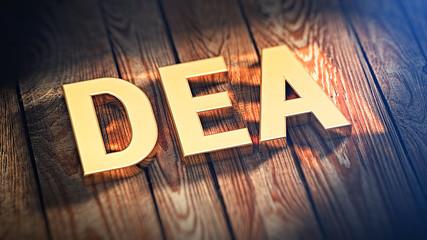 Acronym DEA on wood planks
