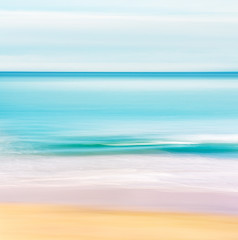 Fototapete - Tropical Ocean Seascape. A seascape in a tropical setting with a calm, turquoise ocean.  Image made with motion blur and a long exposure.