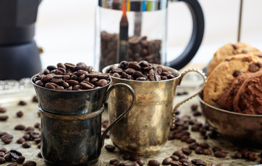 Two cups with coffee beans