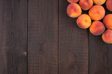 Peaches on old wooden table.