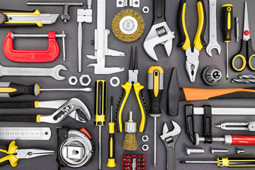 tool set of pliers, wrenches, hammer, clamps, screwdrivers on gr