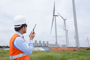 Engineers working at wind turbine power generator   station