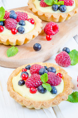 tartlets with custard and berries