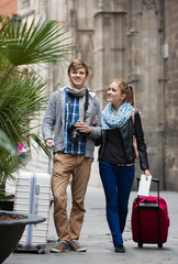 Couple sightseeing and taking pictures of Europenian city