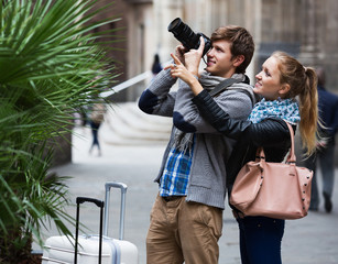 Beautiful couple sightseeing and taking pictures
