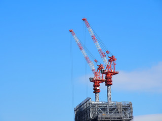 In the blue sky, building construction crane