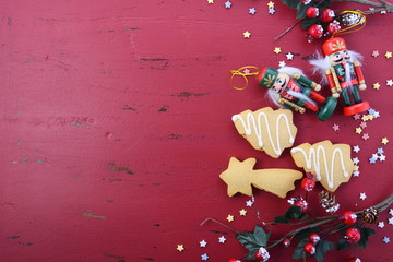 Christmas background with ornaments on red wood table.