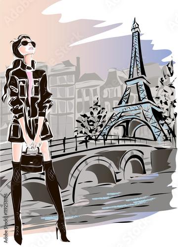 Wall mural Fashion woman in Paris near Eiffel Tower