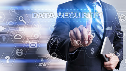 """Businessman is pressing on the virtual screen and selecting """"Data security""""."""