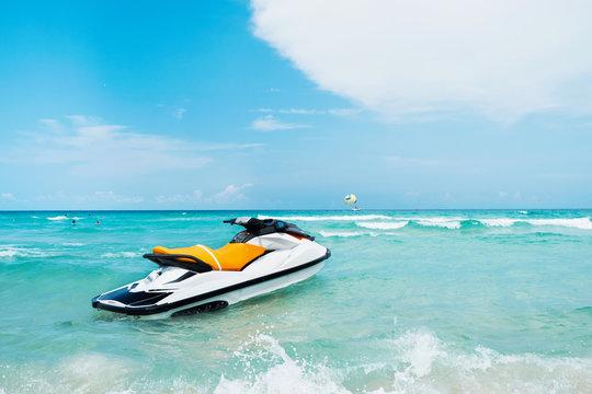 Blue sea and a jet ski floating on the sea, with a blue sky back