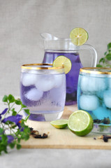 Glass of Butterfly Pea Drinks with Jar on Background