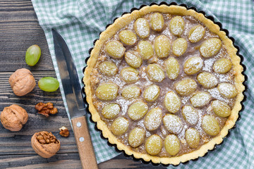 Shortbread dough grape tart with walnut praline, top view, horizontal