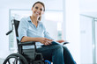 Smiling young woman in wheelchair