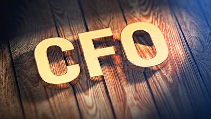 Acronym CFO on wood planks