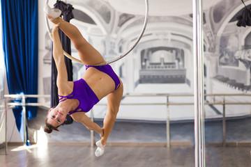 Beautiful pole dancer  in the dance studio