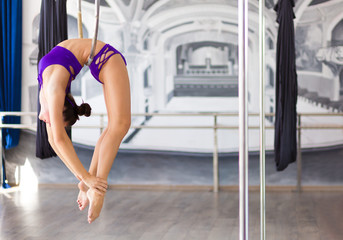 Beautiful pole dancer  in the dance studio