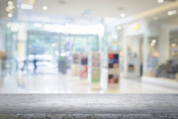 Empty top of granite stone table and shopping mall interior back