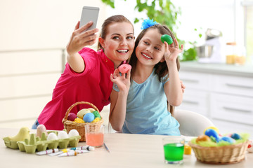 Mother and daughter taking selfie at Easter time