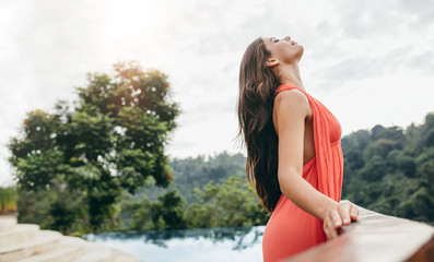 Woman at resort enjoying the climate and fresh air