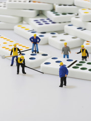 Group of engineer workers are making dominos