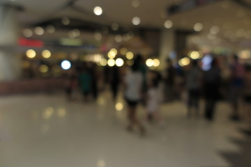 Shopping mall, modern trade with people in blur background with bokeh