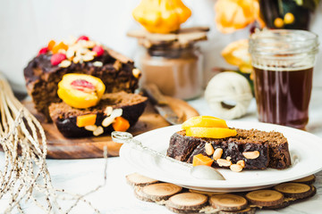 piece of chocolate cake with pumpkin, nuts and fresh peaches, se