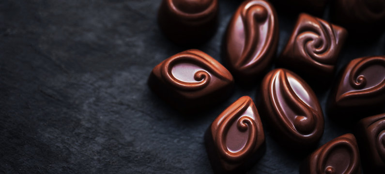 Delicious chocolate candies background.  Assortment of delicious