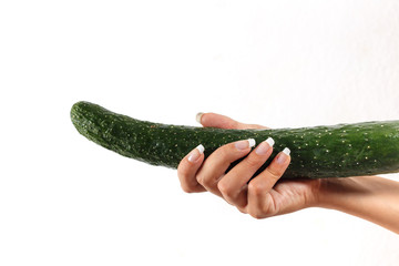Beautiful woman's hand holding a big cucumber