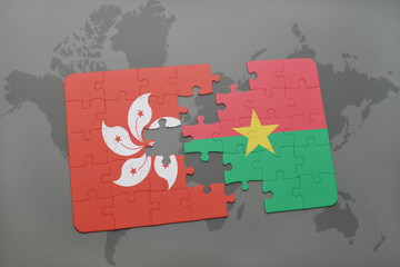 puzzle with the national flag of hong kong and burkina faso on a world map background.
