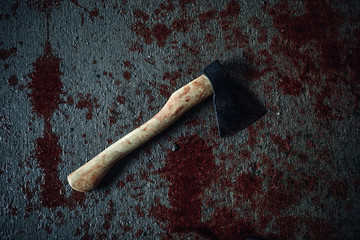 Bloody ax lying on the floor