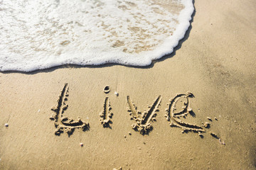 Life. message on the beach.