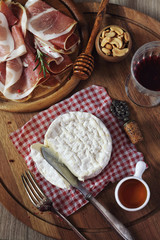 Camembert cheese, cold cuts and red wine