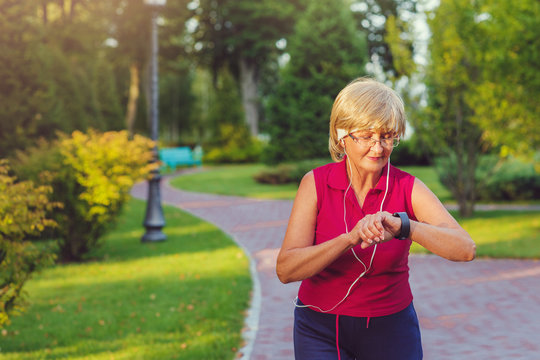 Senior woman setting up the fitness smart watch for running and hecking watch device