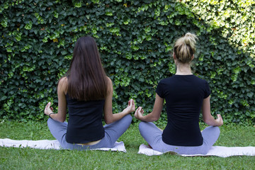 girls meditation outside park