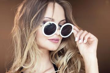 Sexy blonde girl in sunglasses.