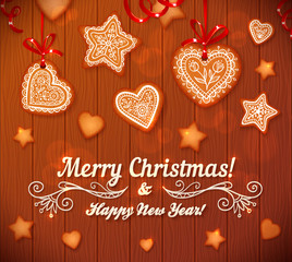 Christmas gingerbread stars and hearts greeting card on wooden background