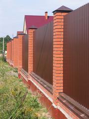 Fence with brick pillars